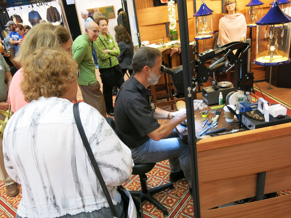 Geoffrey Roth, a watchmaker, had a rig in his booth that would allow curious onlookers to see him at work on large flat-panel displays. His demonstrations attracted quite the audience.