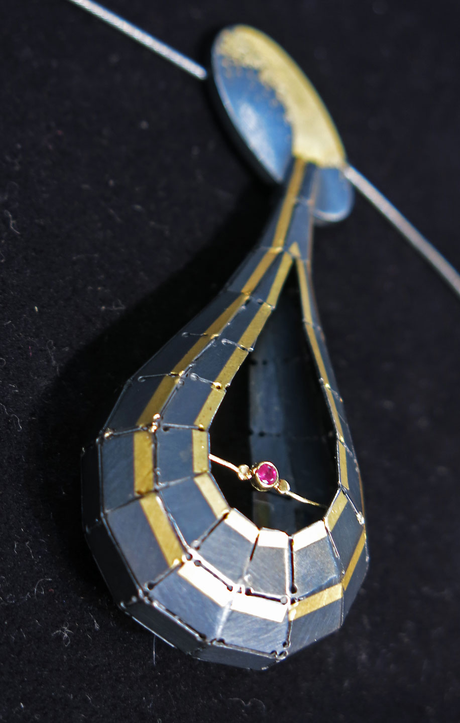 Another view of the previous pendant. SJ says this particular piece was made to represent a teardrop.