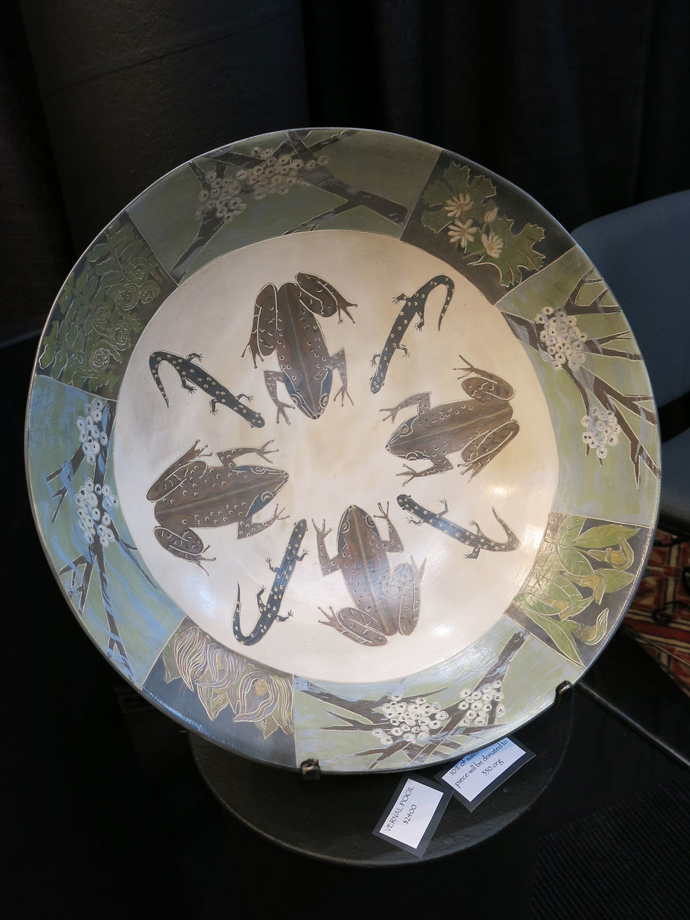 Melissa Greene's pottery is painted with slip; a white base is put over the virginal clay, and then coated with layers of different shades. This piece is called Vernal Pool.