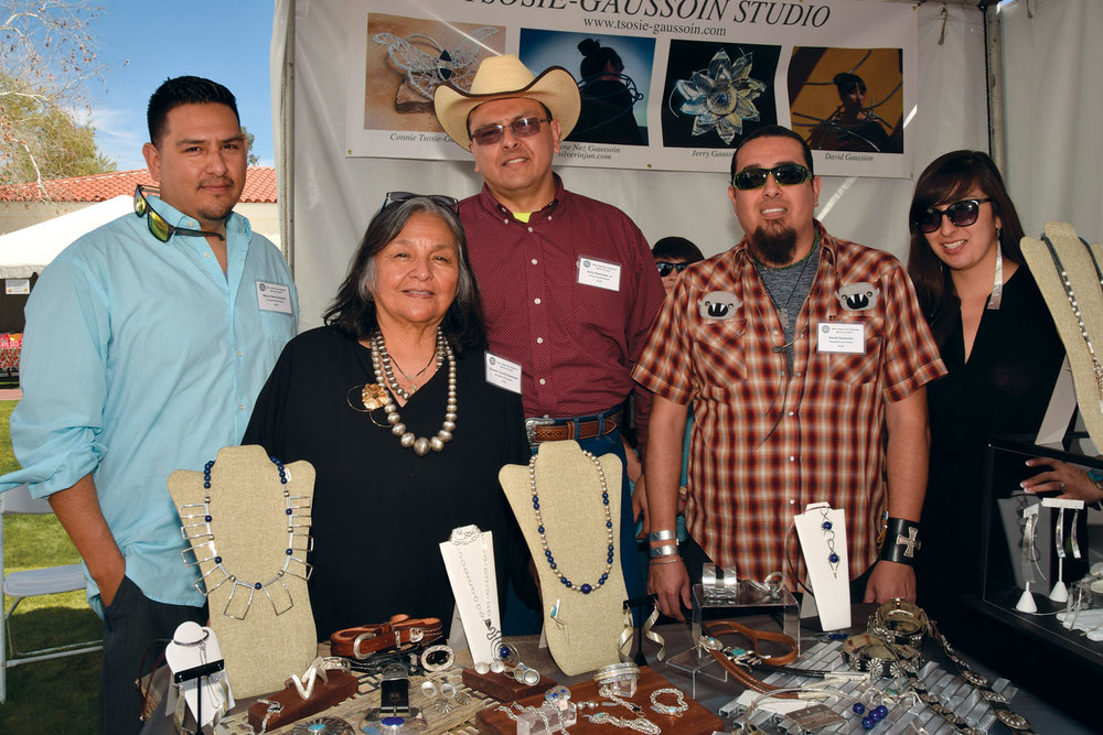 THE TSOSIE-GAUSSOIN FAMILY.  (left to right)  Wayne Nez Gaussoin, Connie Tsosie-Gaussoin, Jerry E. Gaussoin Jr., David Gaussoin, Tazbah Gaussoin, showing at the Heard Museum Guild Indian Fair and Market, March 2017.  Photograph by Margie Zebell-Parrish.