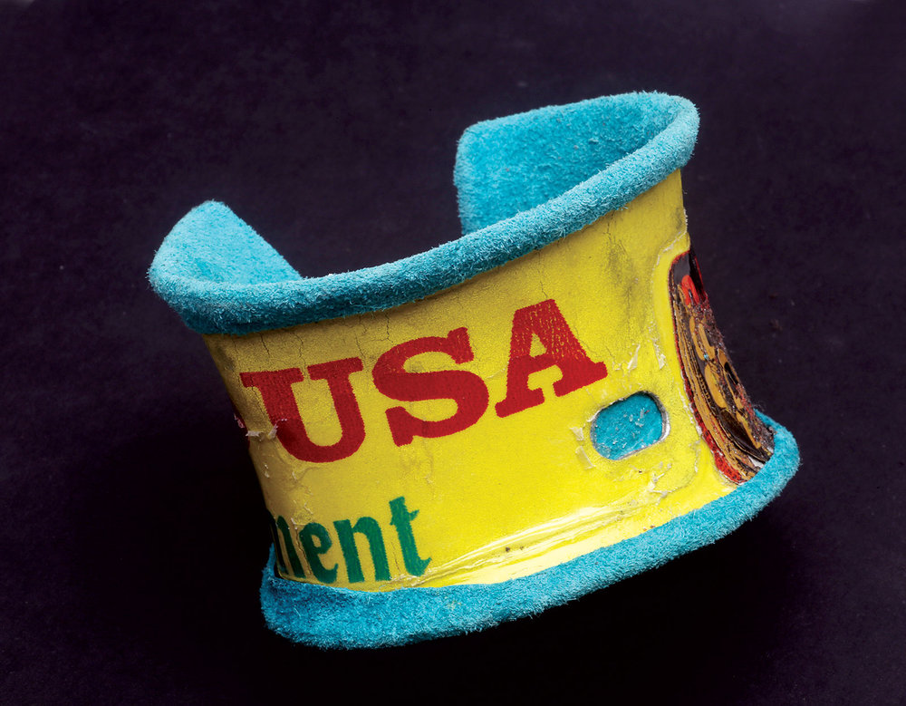 505 SERIES CUFF by Wayne Nez Gaussoin of found object, dyed handcut leather, 8.9 x 8.9 centimeters, 2015.  Photograph by Robert K. Liu.