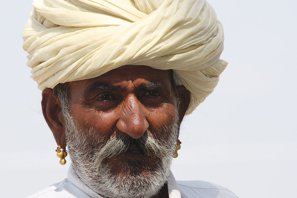 A FARMER FROM THE GUJJAR COMMUNITY wears a pair of gokhru earrings, Pushkar, 2009. Photograph by Thomas K. Seligman.