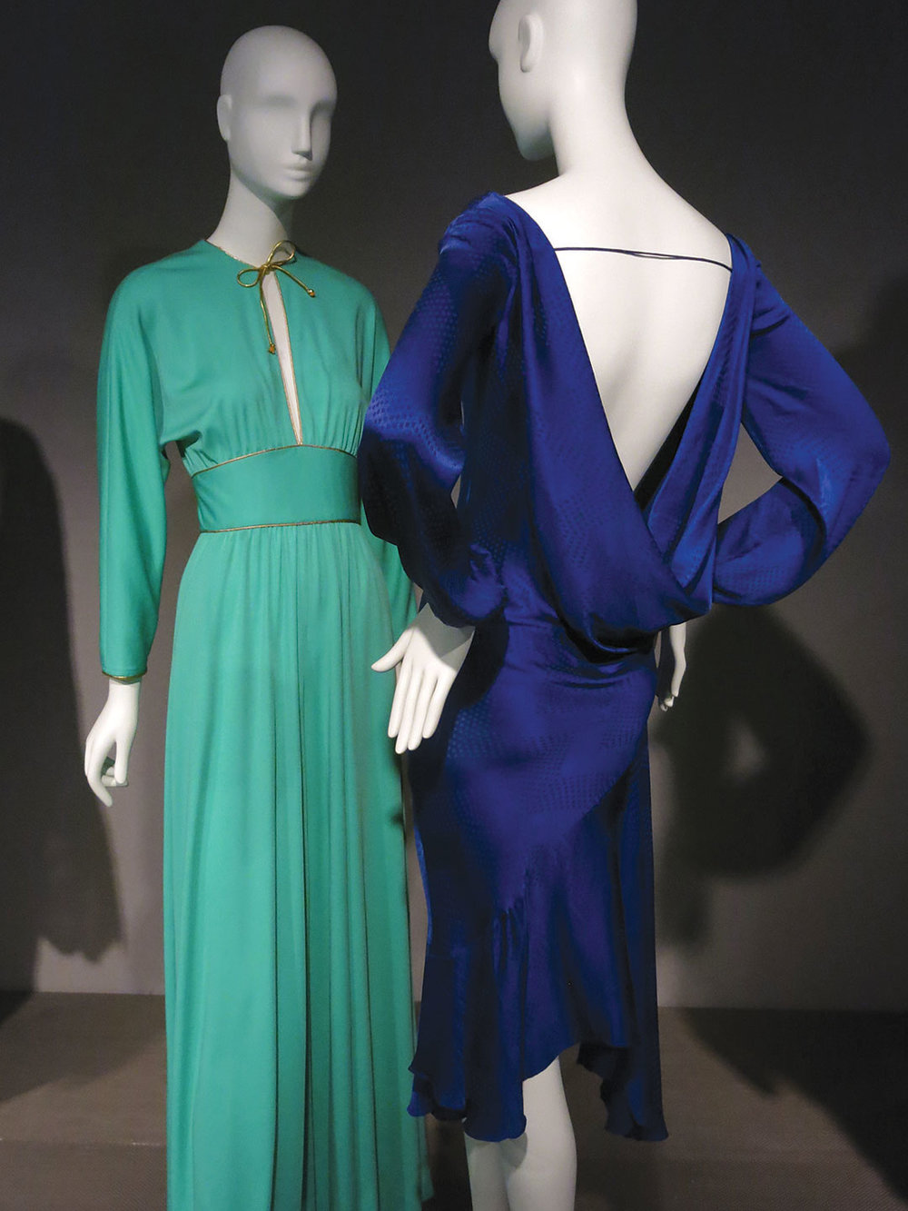 JUMPSUIT by James Daugherty of polyester matte jersey, circa 1974, United States. DRESS by Jon Haggins of silk, 1980-1985, United States.
