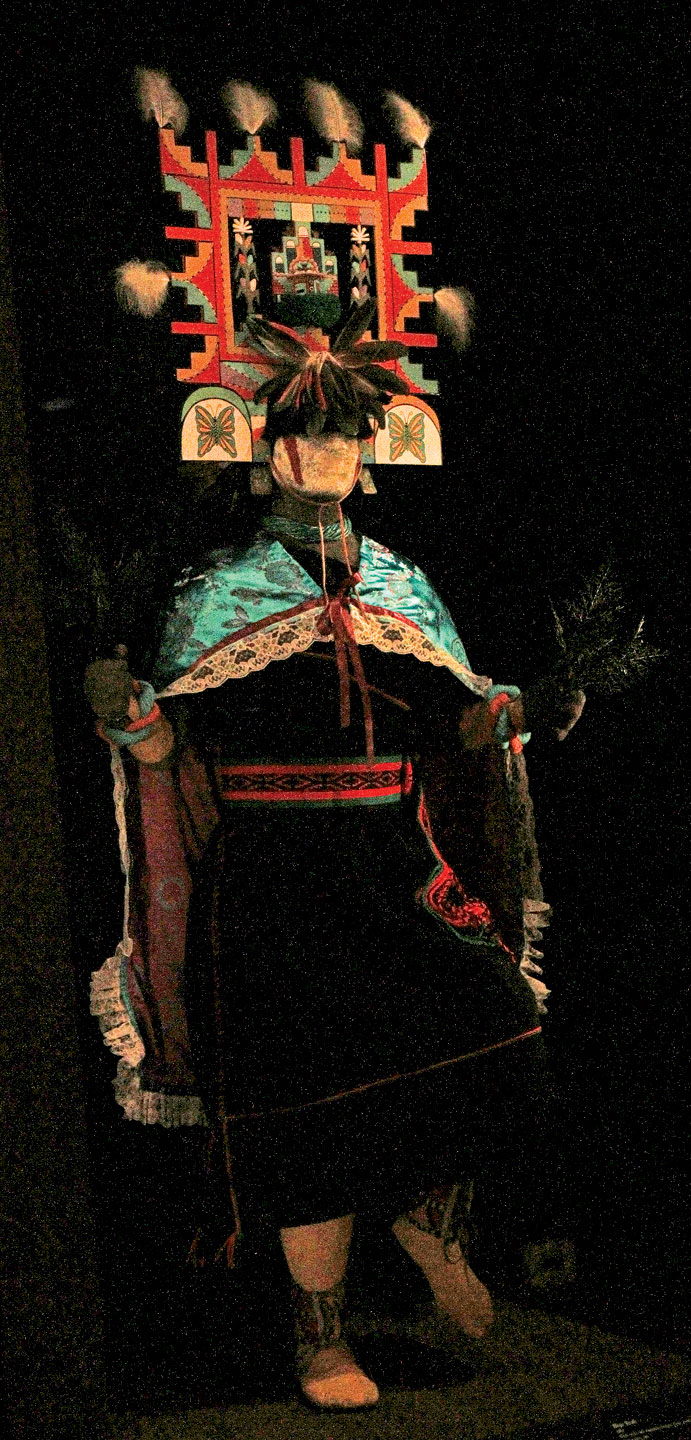HOPI DANCER, HALL OF DANCE, MUSEUM OF AMERICAN INDIAN, shot handheld, with 7D, 17-55mm: f6.3, 1/80, ISO 2000, manual mode. While this picture is much darker exposure, the colors are better. The lighting for the installation was very low, to protect the colors of the costume materials. With more trials, a decent exposure would be possible.