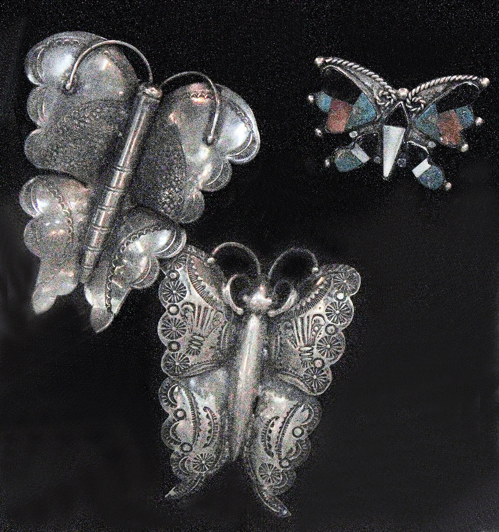 Hopi or Navajo butterfly pins, of silver, with stampwork, probably date from the 1930s to 1940s. An example is in the Doneghy Collection at the MIA, Minneapolis. The small inlay butterfly is most likely Zuni.
