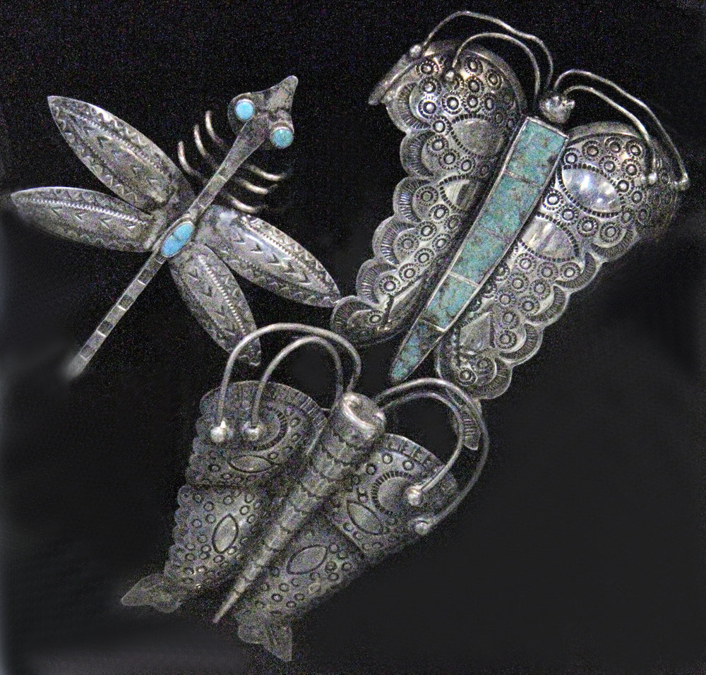 Vintage silver dragonfly and two butterflies, some set with turquoise, all with stampwork. Hopi or Navajo, all courtesy of Jonathan Hill, Santa Fe.