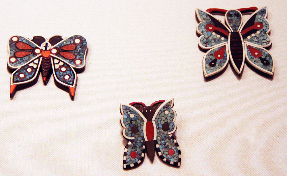 Butterfly pins, probably from Santa Domingo Pueblo and possibly made from late 1920s to 1950s. Often called Depression jewelry, as they were made from non-precious or low-cost materials like phonograph records/battery cases, other plastics and gypsum, as well as turquoise. Because we walked through the Philips galleries rather quickly, due to the volume of material, I did not have time to record the captions on the displays. These bear some similarity to polymer butterflies made in recent years. Courtesy of the Wheelwright Museum, as are the last two images.