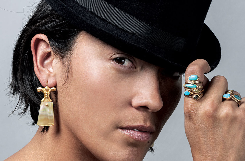YELLOW MUSSEL SHELL TAB EARRINGS AND STACKING RINGS of twenty-two karat yellow gold and yellow mussel shell; rose-cut colored diamonds, turquoise and twenty-two karat gold, 5.1 x 3.2 x 0.6 centimeters; 1.9 x 1.9 x 0.6 centimeters, 2016. Model: Shayla Blatchford. Photograph by UnderexposedStudios.com
