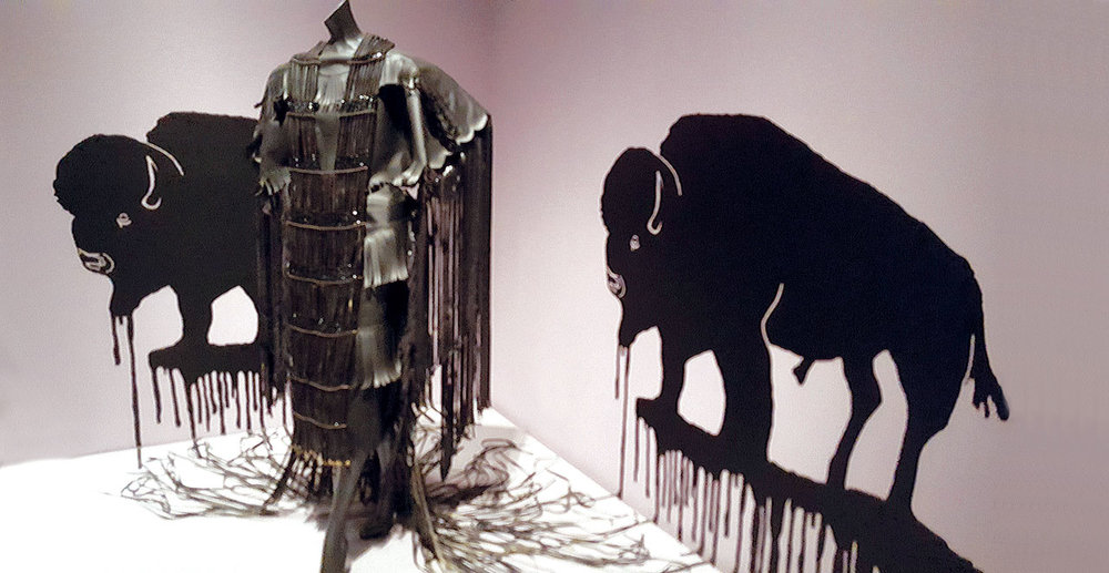 SIKAHPOYII, BISHEE, BALEIITTAASHTEE (MOTOR OIL, BUFFALO, DRESS) by Wendy Red Star (Apsáalooke) and Terrance Houle (Blood) of vinyl and plastic beads, paint, 2013.  Photograph by Ornament.