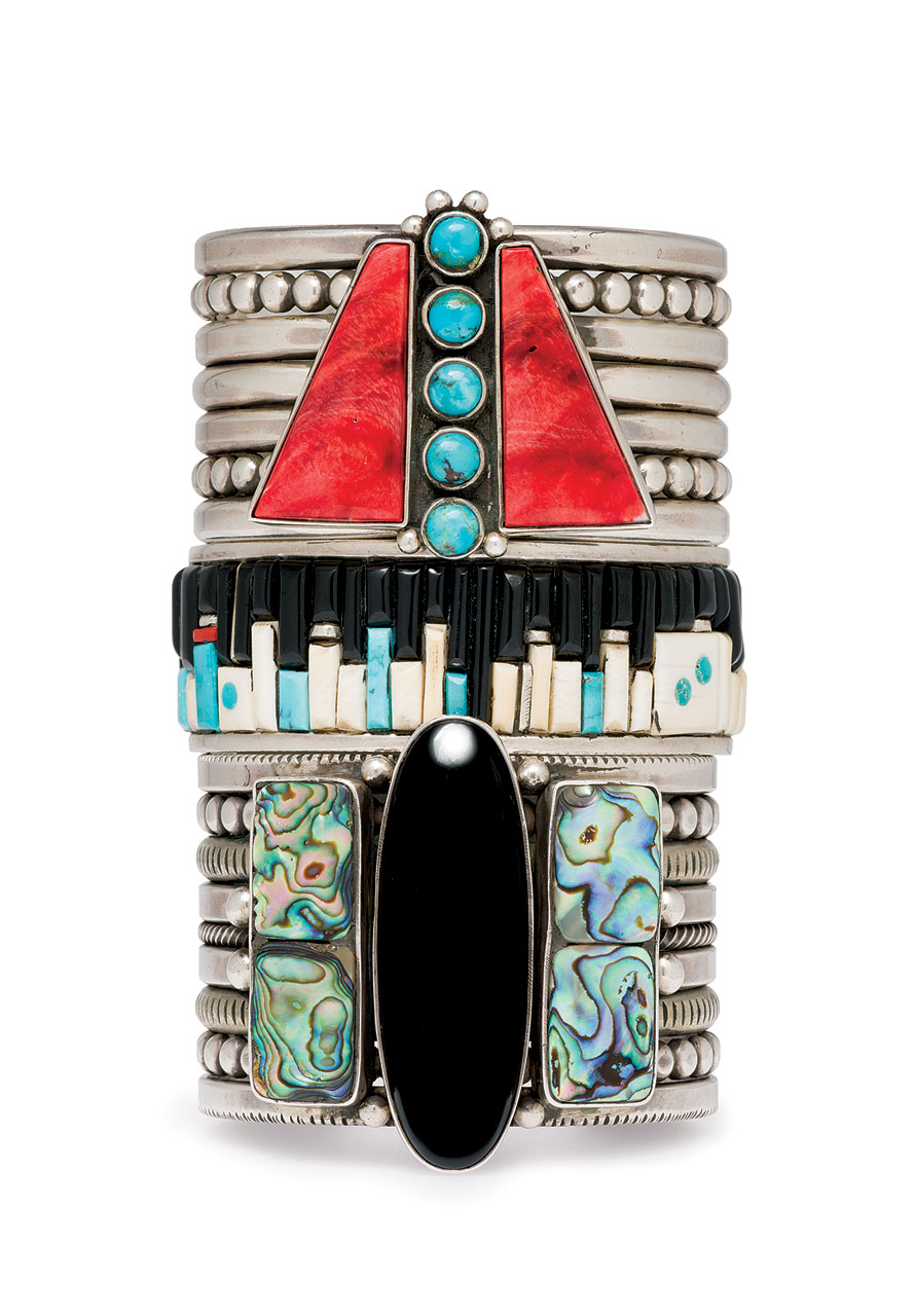 BRACELETS by Mike Bird-Romero (Ohkay Owingeh Pueblo) and Eddie Begay (Diné) of sterling silver, spiny oyster, abalone shell, turquoise, jet, and onyx, 2000-10.  Photograph by Walter Silver; courtesy of Peabody Essex Museum.