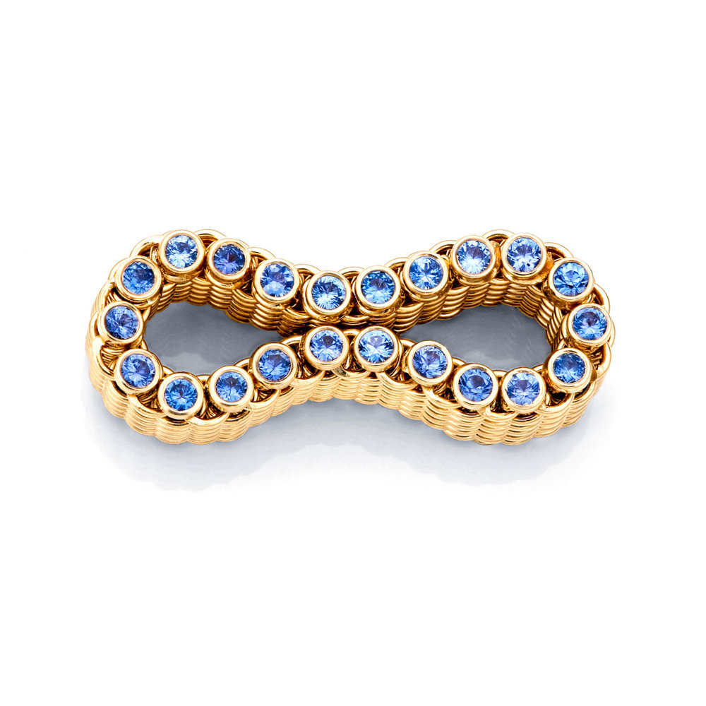 JASON BAIDE. Flexibility Ring of fourteen karat yellow gold and Montana Yogo sapphires.  First Place Emerging Jewelry Artist 22 Years or Younger.