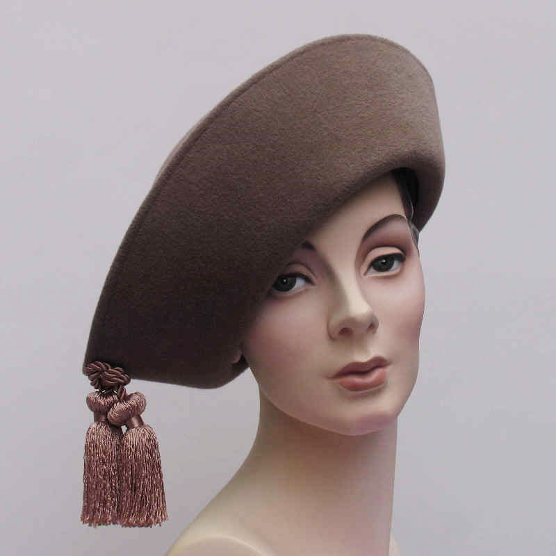 TASSEL TOQUE of taupe velour felt, rayon braid and tassels, 2001.
