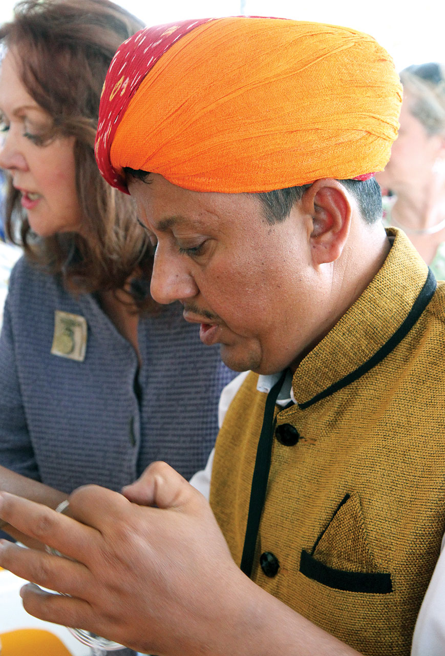 """DHARMENDRA SONI, from Rajasthan, India, at his booth; he was one of four jewelers who participated in """"Enduring Splendor,"""" an exhibition of Indian jewelry at the Fowler Museum at UCLA.India has a long tradition of fine metalworking and jewelrymaking. Dharmendra Soni belongs to a caste of jewelers known as sonis, thus his family name signifies his occupation."""