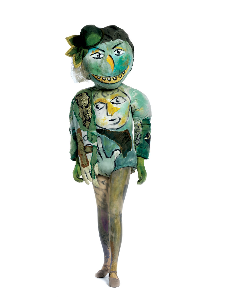 GREEN-FACED MONSTER (WITH REPRODUCTION MASK) of cotton knit, painted, with synthetic/lurex plain weave appliqués, silk plain weave (chiffon) appliqués, synthetic knit, painted, and  papier-mâché .