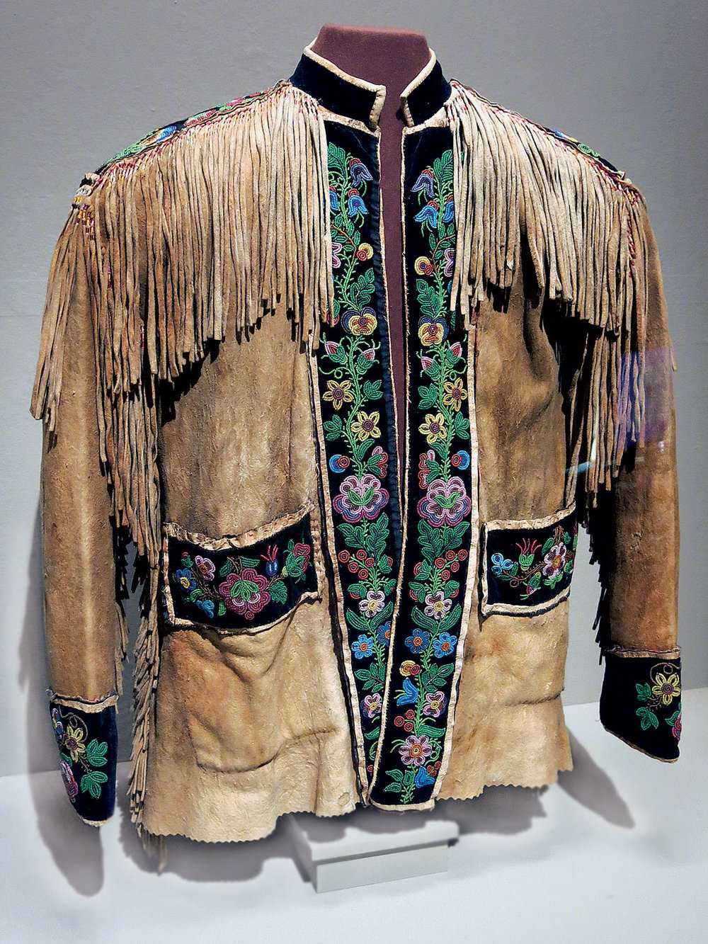 MÉTIS CREE COAT, 76.2 x 71.1 centimeters, circa 1900. Although the cut of this coat suggests that it was made during the late nineteenth century, it is possible that the beadwork is earlier and has been repurposed from another garment.  Private collection. Photograph by Ornament.