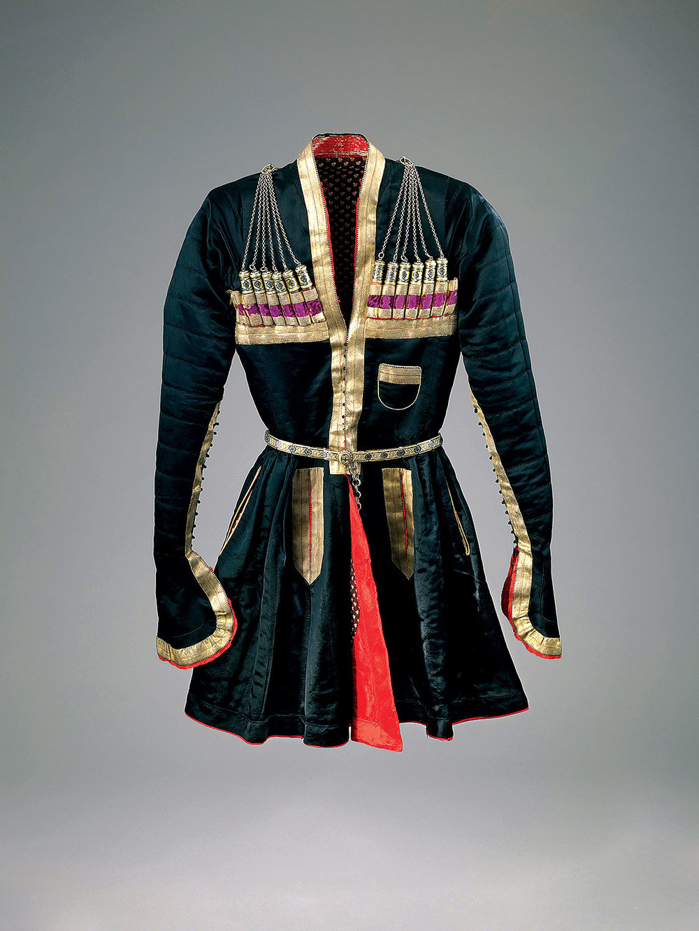 MAN'S COAT of silk, gilt ribbons, silver niello and imitation gunpowder cartridges, Georgia, early twentieth century.  Photograph by Mauro Magliani, courtesy of The Israel Museum, Jerusalem.