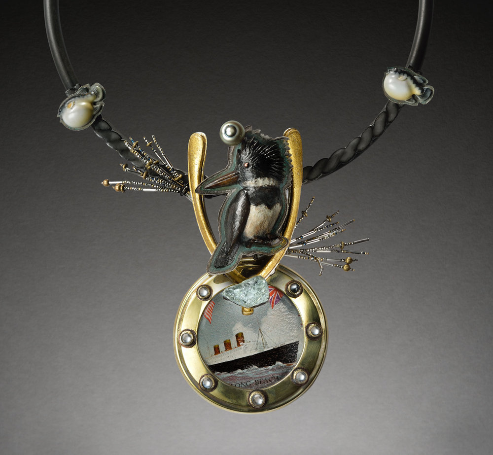 KINGFISHER BON VOYAGE PENDANT of carved boxwood, tin coaster, post-war Japanese porcelain  fugu  buttons, aquamarine, gilded wishbone, sterling silver, brass, fourteen karat gold, enameled iron, 2015.  Photographs by Daniel Fox, Lumina Studio except where noted.