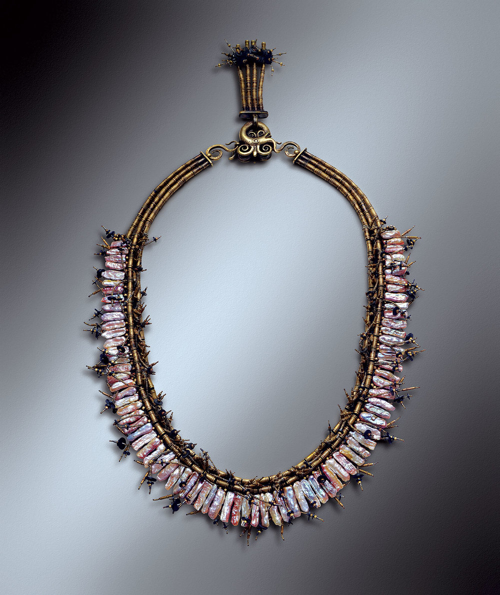 DRAGON STICK PEARL NECKLACE of freshwater pearls, Dyak Indonesian earring, African brass beads, steel-cut beads, and vinyl wafers, 2011.