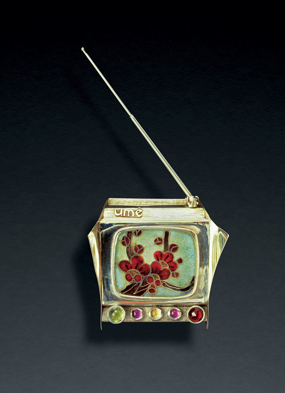 NADINE KARIYA:  UME TV RING CONTAINER of sterling silver,   cloisonné   enamel, jeweled knobs, rotating antenna, 1976.
