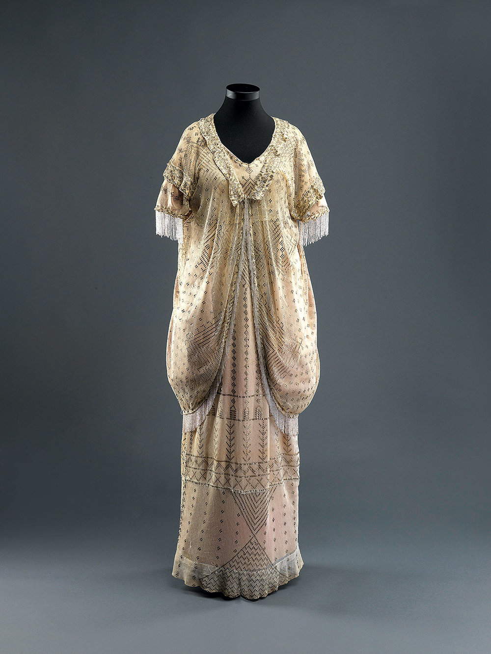 VEILED MEANINGS: WOMAN'S ENSEMBLE of tulle and silver-tinsel embroidery, probably Alexandria, Egypt, 1920s.  Photograph by Elie Posner, courtesy of The Israel Museum, Jerusalem.