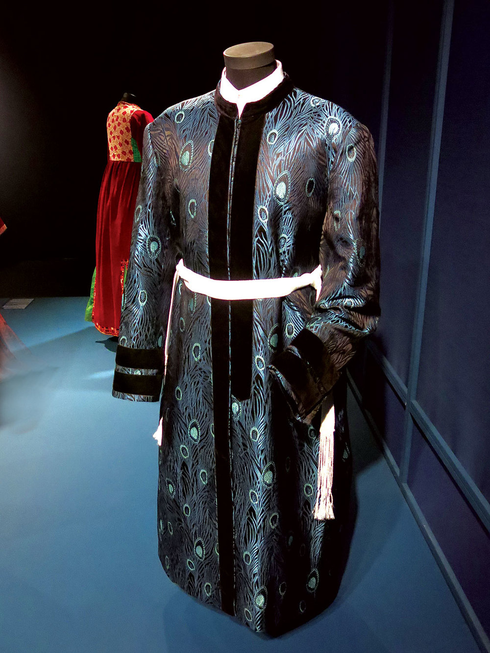 VEILED MEANINGS:  HASIDIC REBBE'S SABBATH COAT of silk, synthetic thread, appliqué synthetic velvet bands, and silk sash, Israel, early twenty-first century.  Photograph by Patrick R. Benesh-Liu/Ornament.