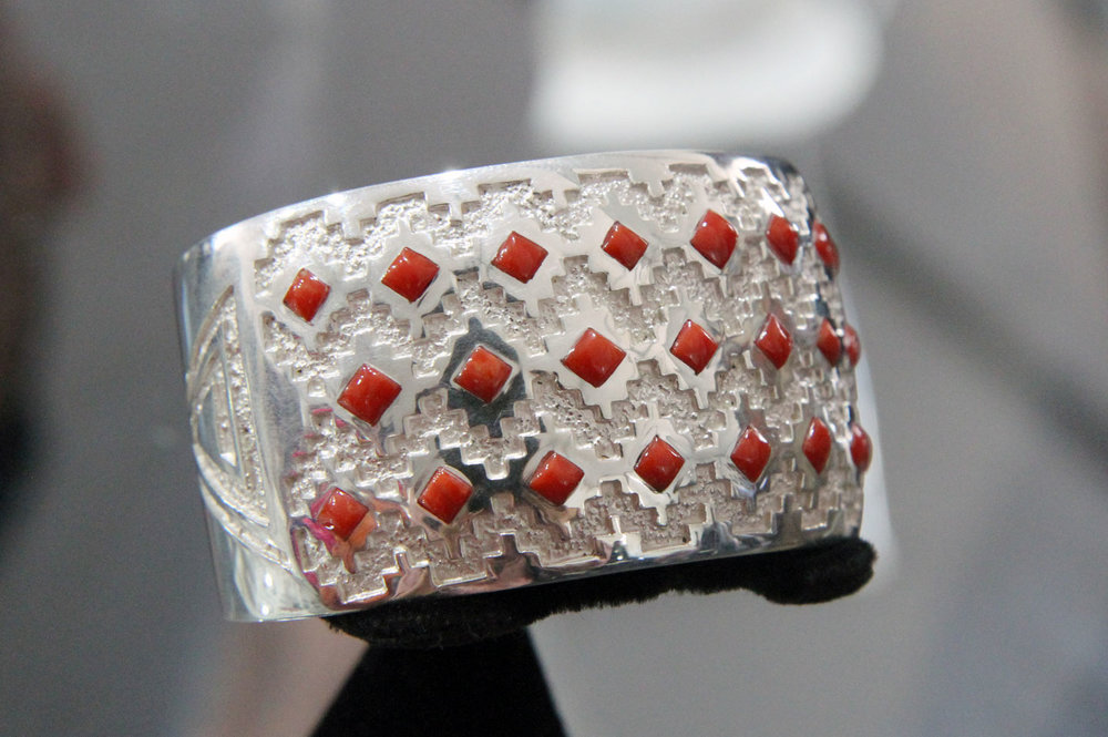 BRACELET with overlay and coral by Michael Perry.
