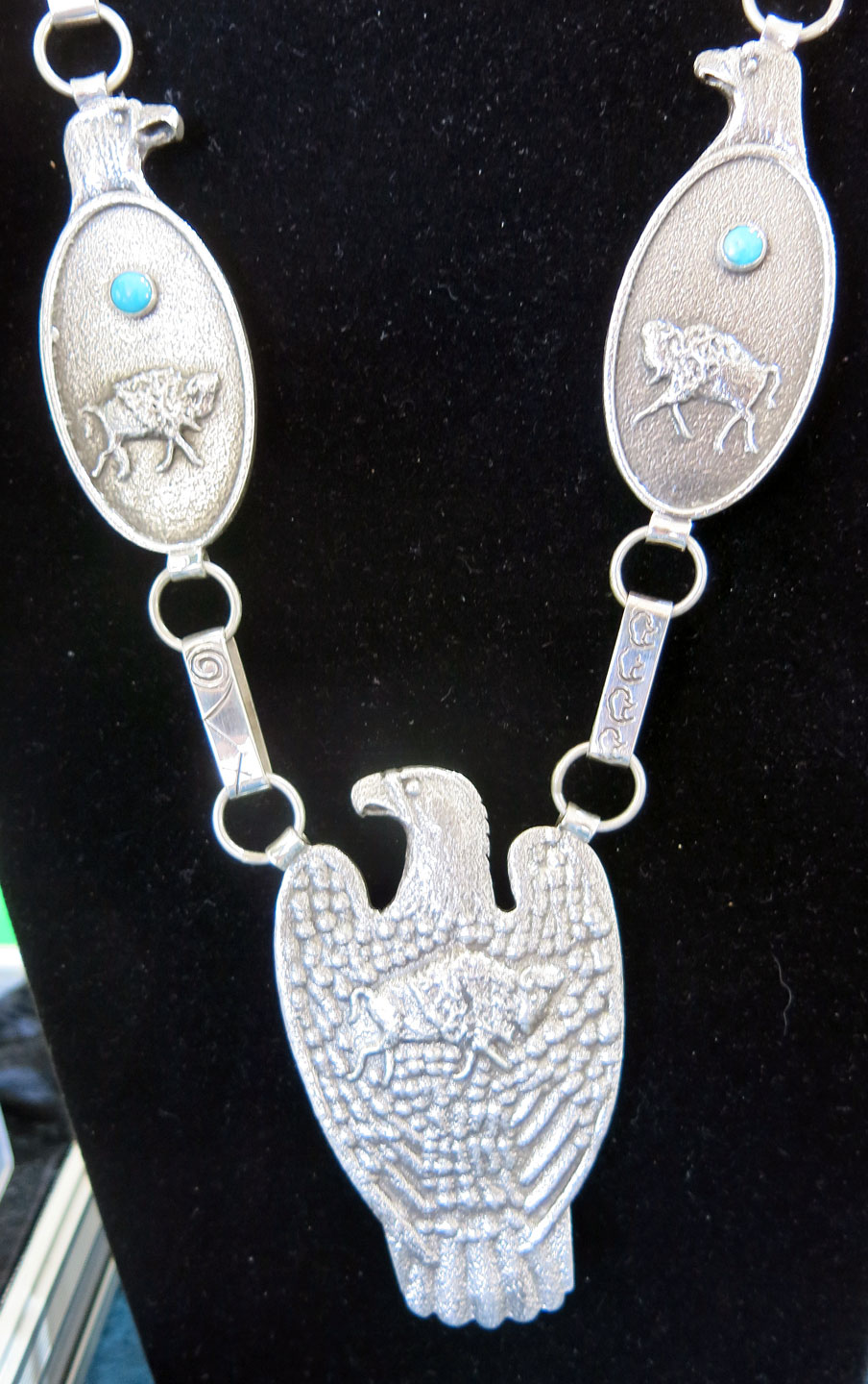 EAGLE PENDANT by Anthony Lovato, tufa-cast in silver with turquoise.