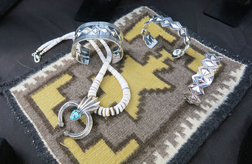 SILVER JEWELRY by Ronnie Henry. Henry is a world traveler who has been to Japan, and finds ways of putting his own personal touch on traditional Native motifs, blending old and new.