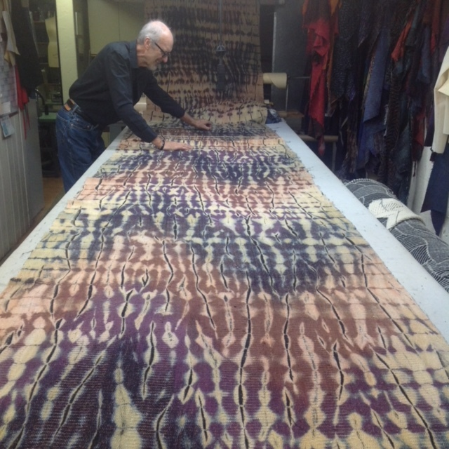 Rodger Footitt cutting wafts of shibori-dyed silk.