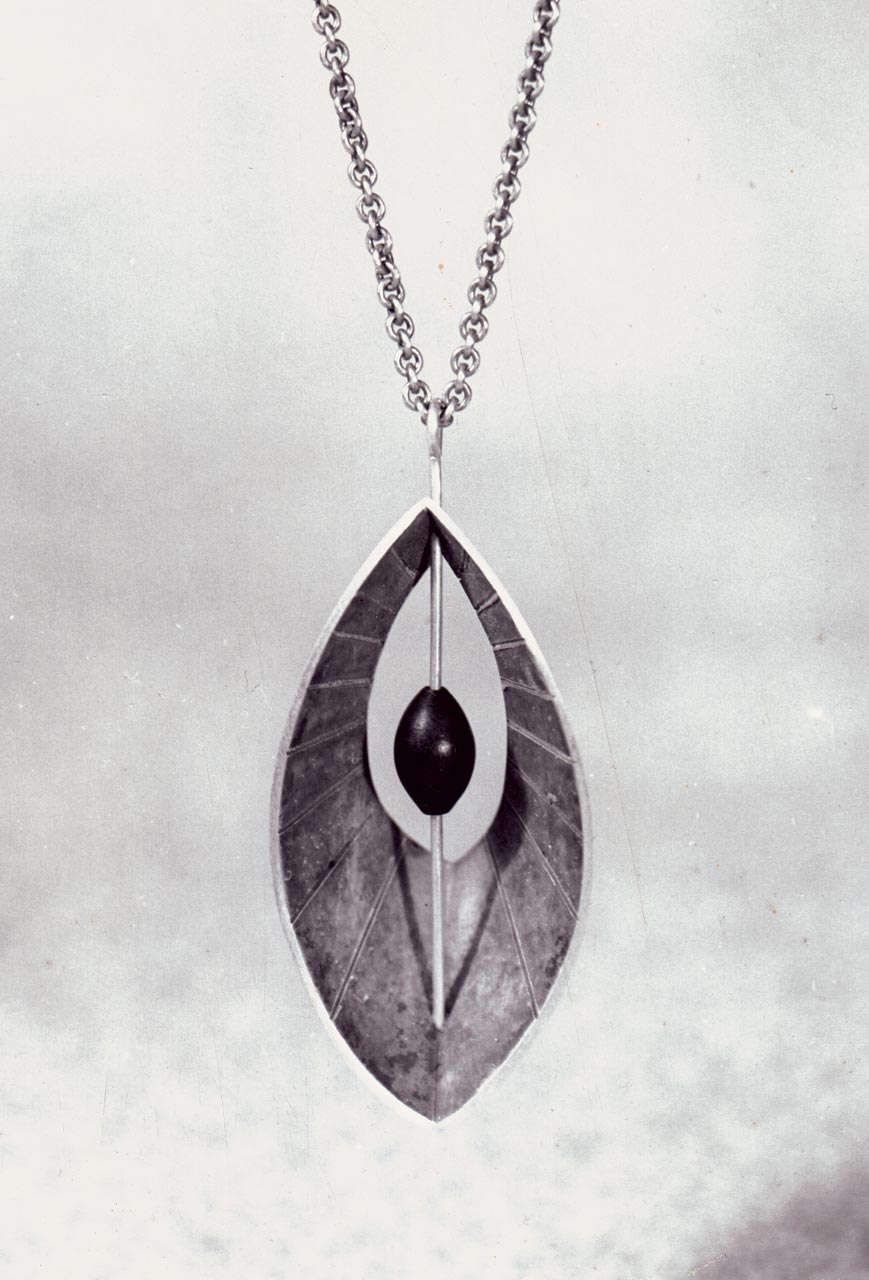 VINTAGE PHOTOGRAPH of a cast silver pendant with ebony bead.  Collection of Jewelry and Metalwork, Lamar Dodd School of Art, University of Georgia. Photograph by Wiley Sanderson.