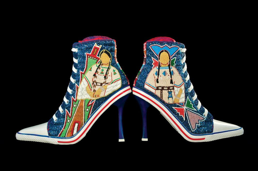 STEPPING OUT:  BEADED STEVE MADDEN SHOES by Teri Greeves (Kiowa/Comanche) of commercial shoes, glass beads, 2017. Among the Kiowa, the men were traditionally the pictorial artists. In contrast, Kiowa women created abstract patterns to encode their knowledge of the world. These shoes celebrate those female artists. Each pair of images shows an abstract pattern drawn from Kiowa parfleches (hide containers) or from the beadwork on moccasins, cradleboards, and other items, and pairs that design with the woman who may have created that pattern and its meaning.  Photograph by Stephen Lang.