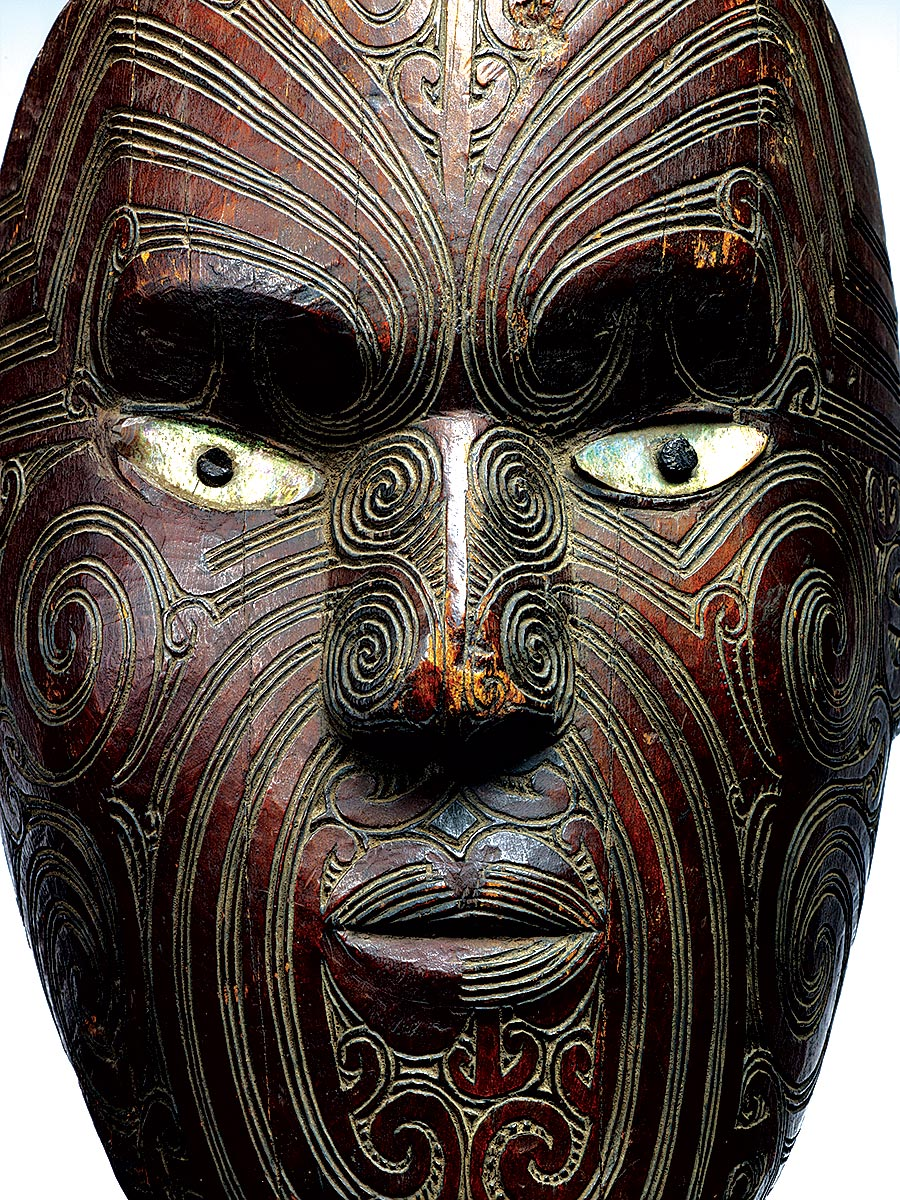 TATTOO:  KORURU OR PARATA (gable mask) of carved wood, white pigment, paua shell, Maori, New Zealand, nineteenth century.  Photograph by Thierry Olivier and Michel Urtado.