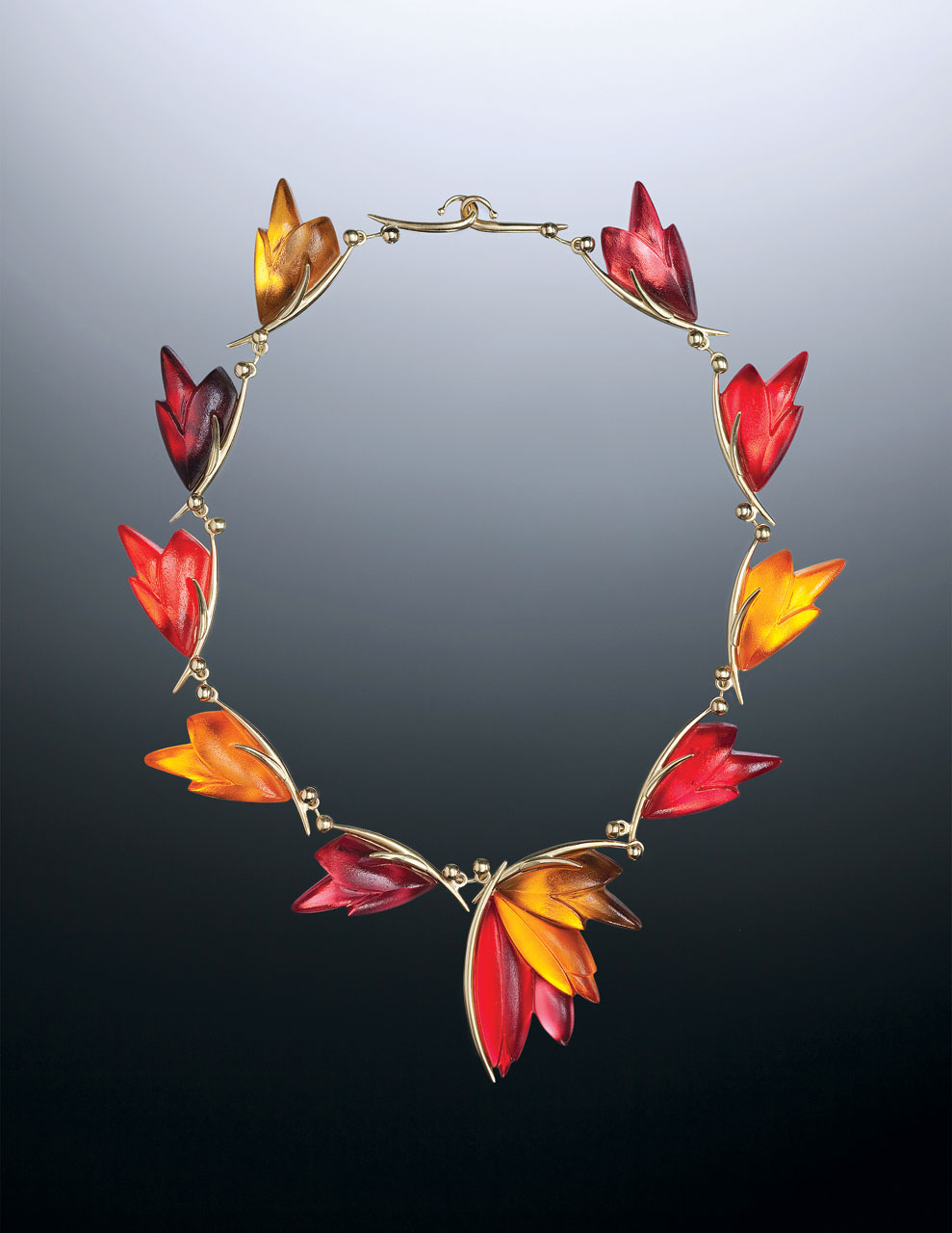 LINDA MACNEIL:  BOUQUET EDITION, FLORAL SERIES NO. 84 NECKLACE of acid polished red, orange, amber, pink, maroon transparent glass, laminated to mirrored glass, polished eighteen karat yellow gold, 20.3 centimeters diameter, 2009.