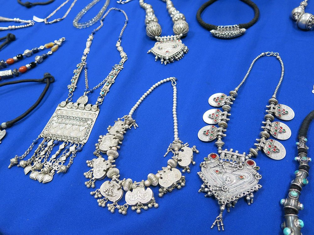 An array of silver pendants and necklaces.