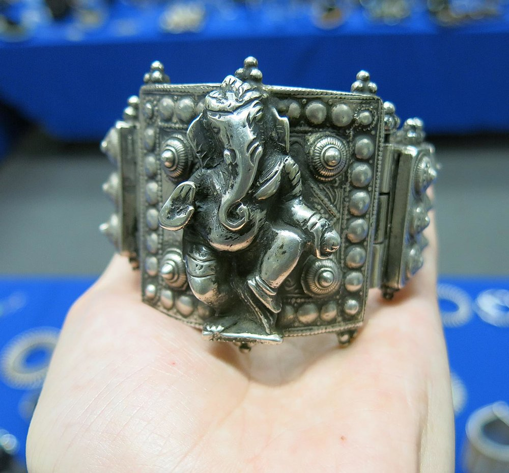 Opposite side of antique silver bracelet with figure of Ganesh.