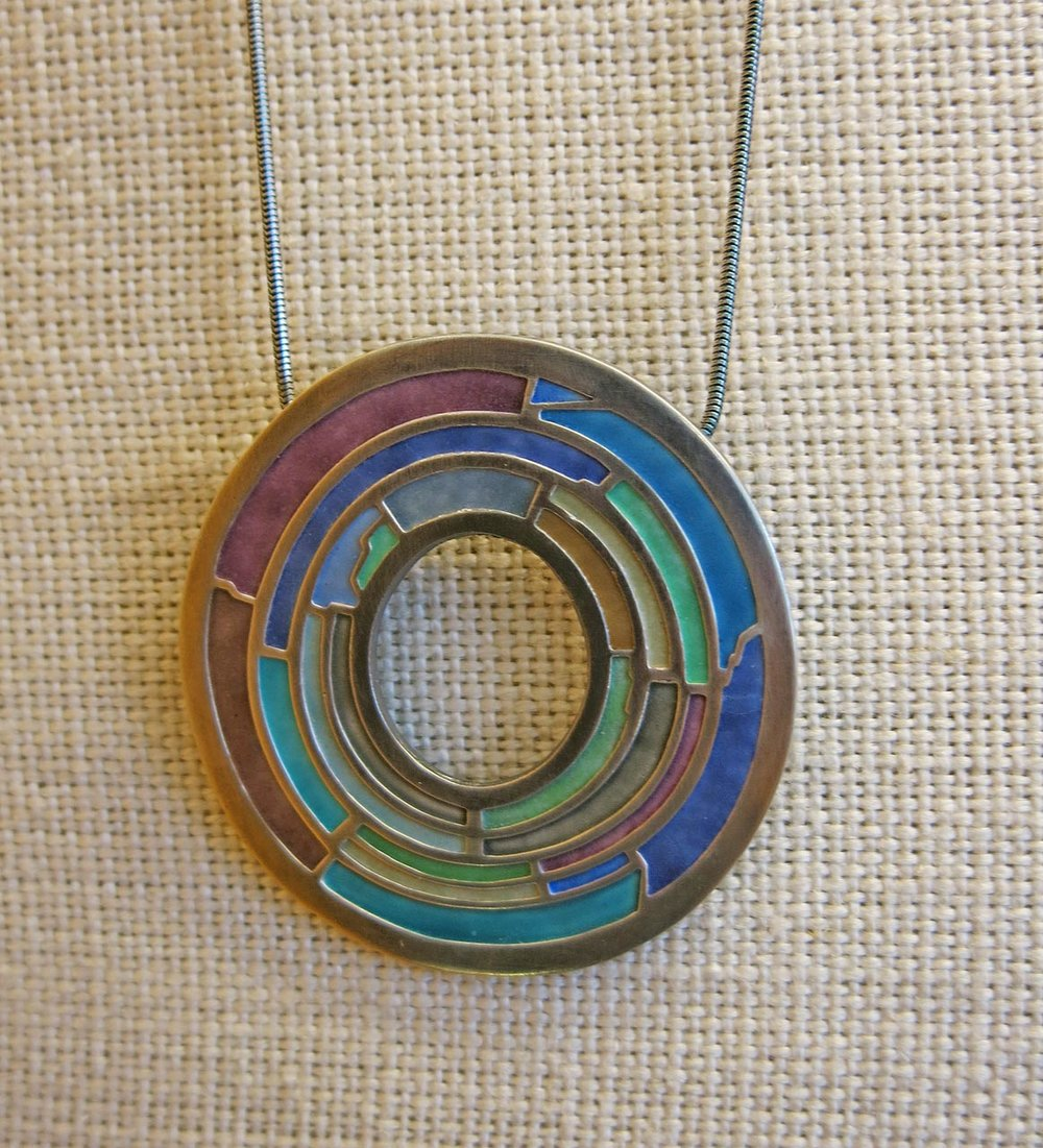 Enameled pendant by Carly Wright, utilizing champlévé.