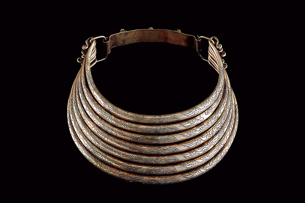 MIAO WOMAN'S NECKLACE, of seven layers with dragon motifs, of silver alloy, engraved, Guizhou Province, China, mid-twentieth century.  Photographs courtesy of The Textile Museum.