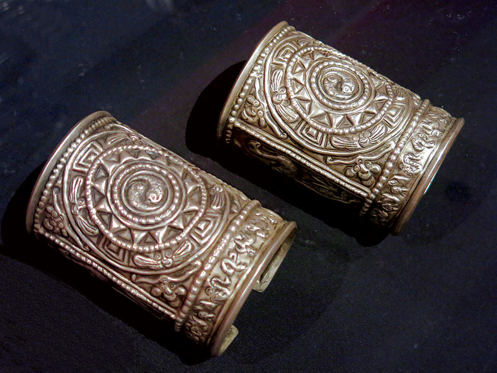 DONG BRACELETS of silver, stamped, repousséd, Guizhou Province, China, mid-twentieth century.  Photograph by Patrick R. Benesh-Liu.