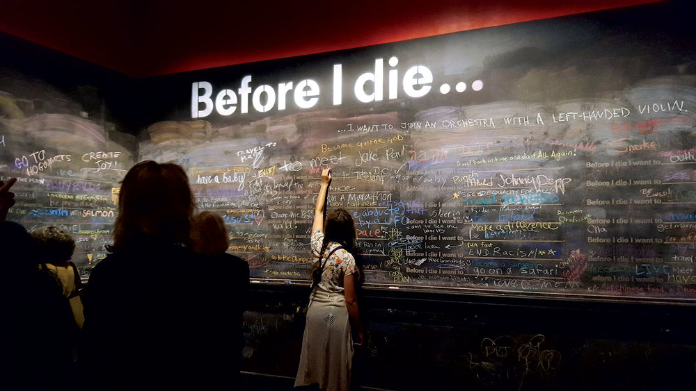 BEFORE I DIE by Candy Chang (New Orleans, Louisiana), 2011. As an experiment in community building, and healing, Chang created the first wall on an abandoned house in her neighborhood of New Orleans. A response to a loved one who had just died, now these participatory installations, like David Best's Temple, allow its audience an intimate relation with the art. In fact, the audience is part of the art itself.  Photograph by Carolyn L.E. Benesh.