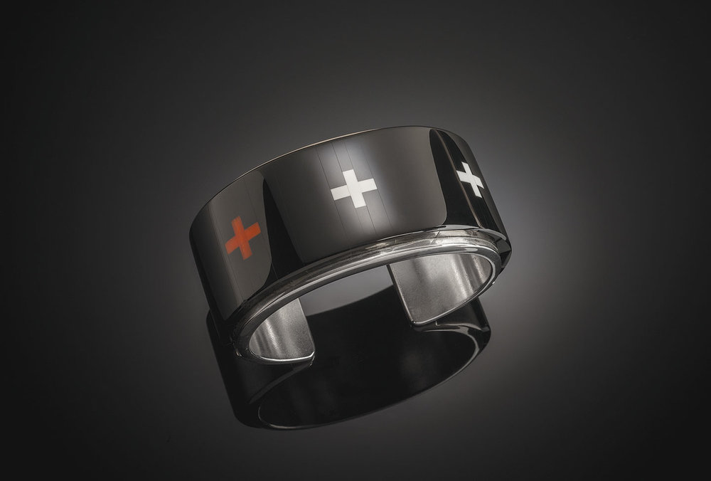 RICHARD CHAVEZ:  BRACELET of black jade, coral, dolomite, and silver, 3.0 centimeters wide, 2010.  Private Collection.