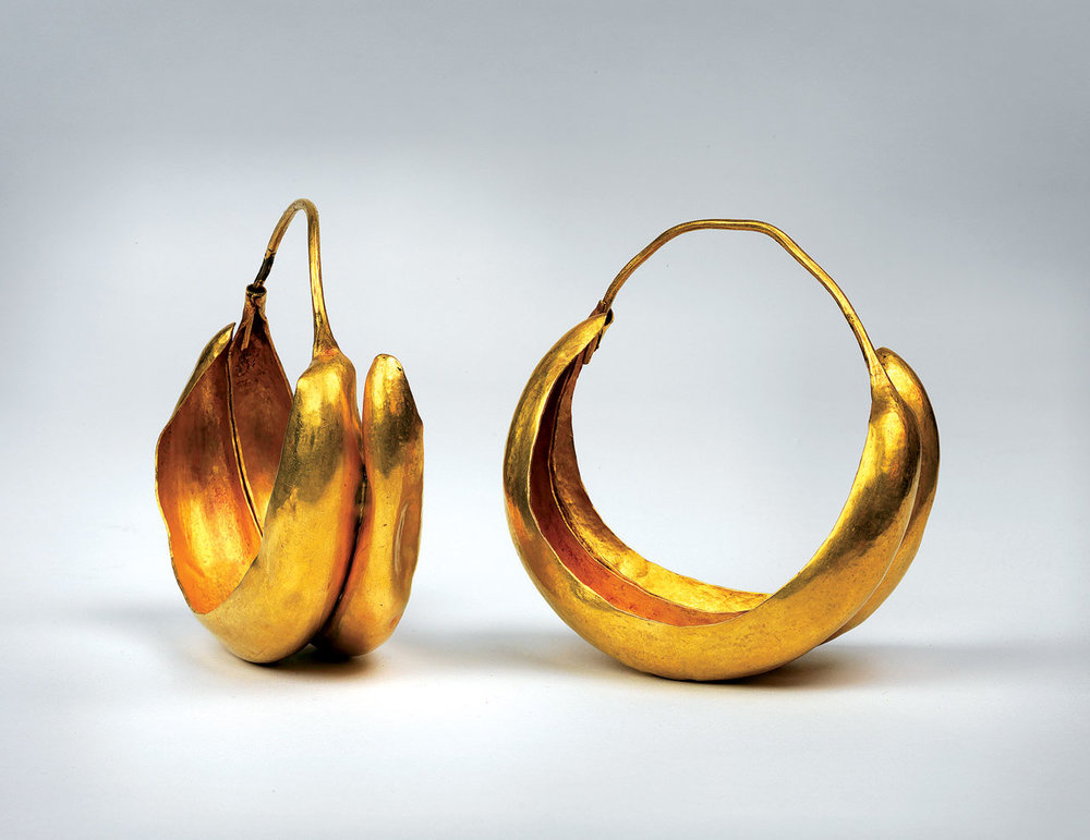 PENN MUSEUM:  LUNATE EARRINGS of hammered gold, worn by Queen Puabi, 2450 B.C.