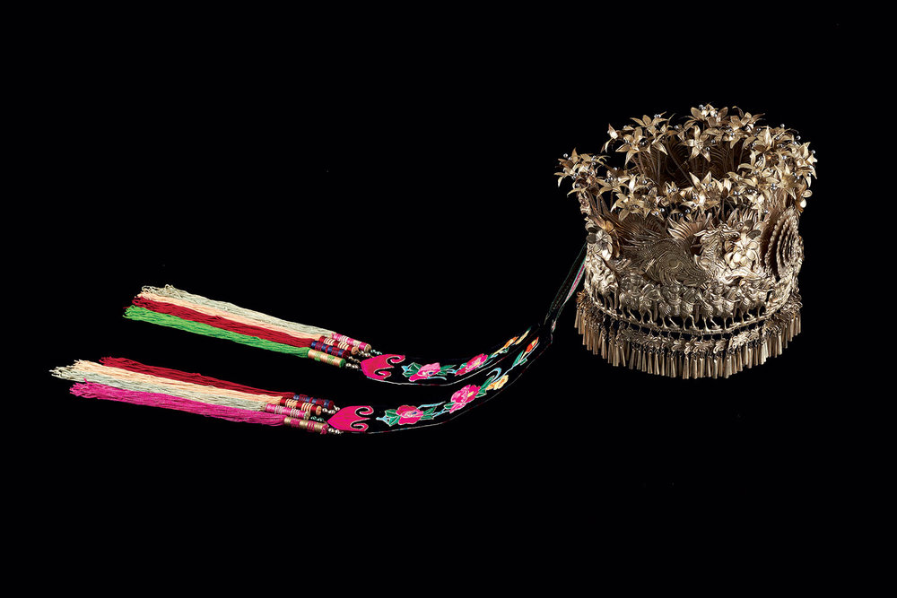 MIAO FESTIVAL CROWN of silver alloy, cotton and silk streamers, Leishan County, Guizhou Province, China, 1980s.  Photograph courtesy of The Textile Museum.
