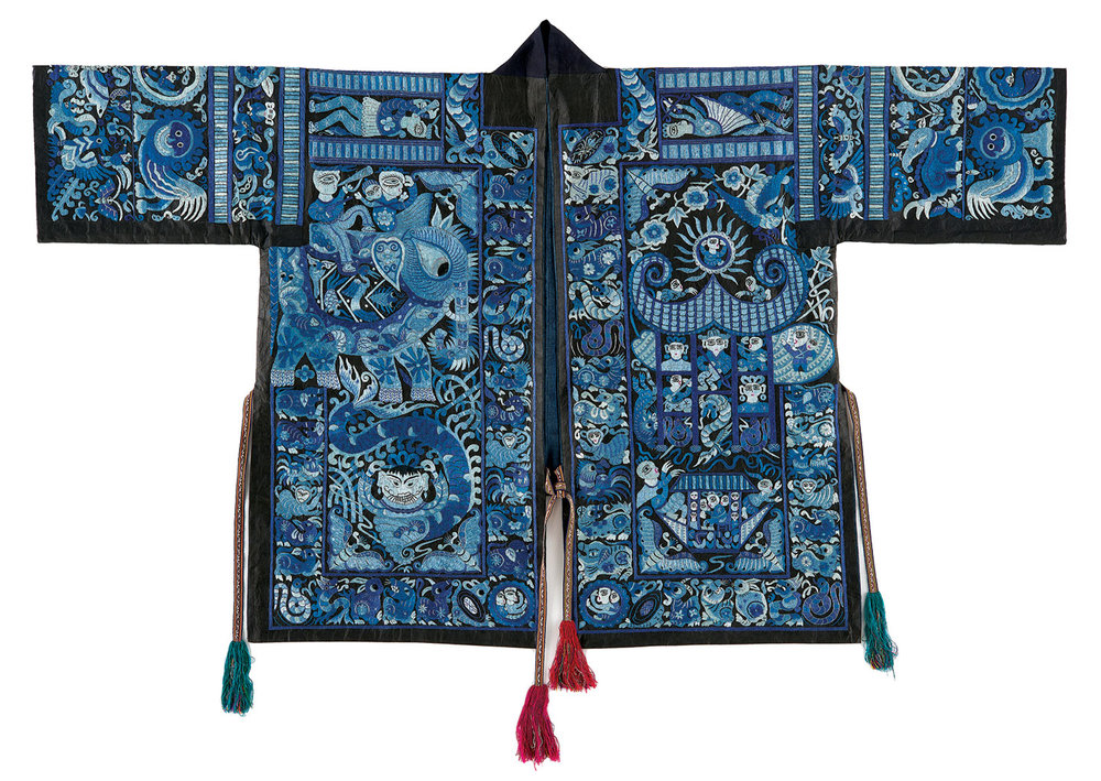 MIAO WOMAN'S FESTIVAL JACKET of cotton, silk, embroidered, Taijiang County, Guizhou Province, China. Dating from the 1950s, this ceremonial costume was once worn by the wife of the Guzang Festival's leader. Detail is from the back of the festival jacket.  Photographs courtesy of The Textile Museum.