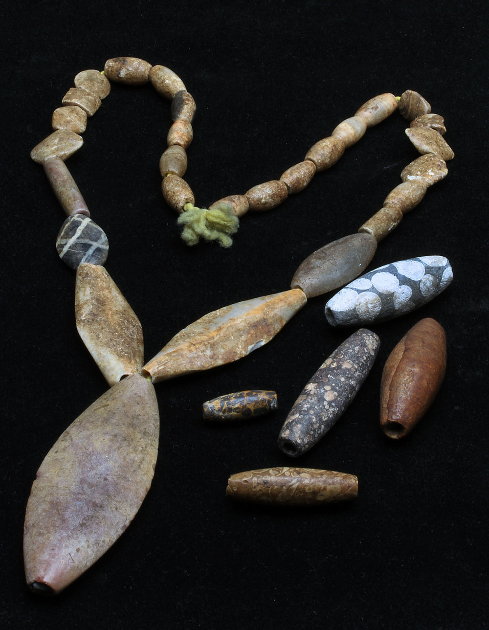 Strand of ancient stone beads from Afghanistan, collected in the 1960s by David K. Liu, of non-precious stones but note excellent crafting. Loose beads are also ancient, from the 1980s, courtesy of the late J. L. Malter. RKL
