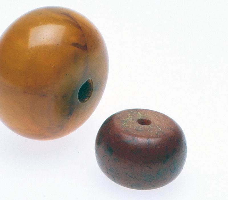 Two bakelite beads imitating copal or amber. CW