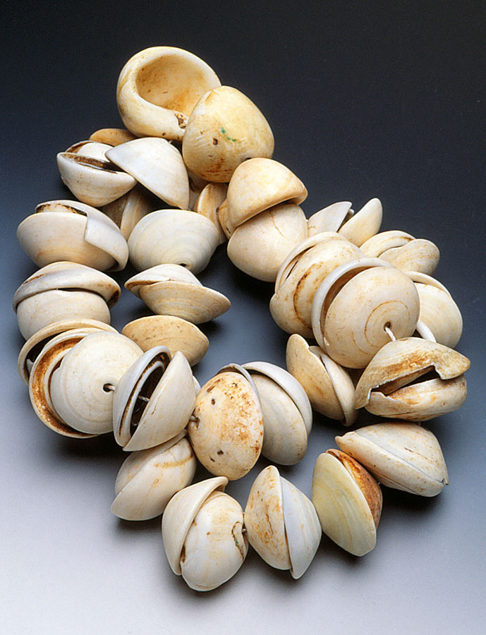 Beautiful strand of conus shell disks, strung as opposing pairs; such ornaments were probably never used like this. RKL