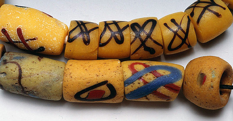 Assortment of Akoso beads, including five Venetian lampworked imitations on the right upper strand. The real akoso beads have preformed decorations of varying widths and colors. RKL