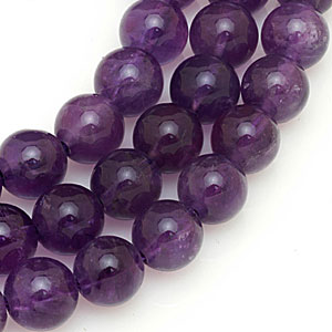 Contemporary amethyst beads cut and drilled in Hong Kong. CW