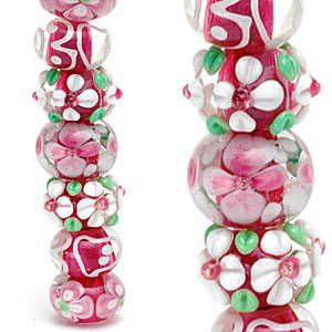 Contemporary lampworked glass beads with Arabesque-style decoration. CW