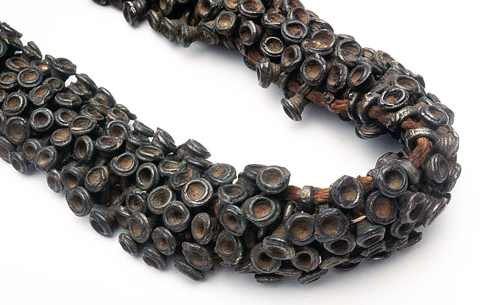 Small cast iron bell-shaped beads from India, Orissa. Multiple strands strung together to give striking appearance. RKL